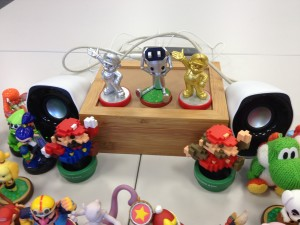Just place an amiibo on this device and it will play a track relating to that amiibo's character!