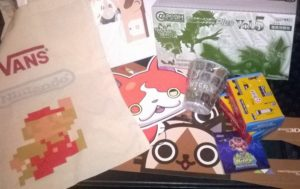 StreetPass Donegal swag pile! Contains donations from Nintendo, Capcom and Yelp